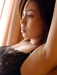Gorgeous asian beauty takes off her lingerie and goes topless