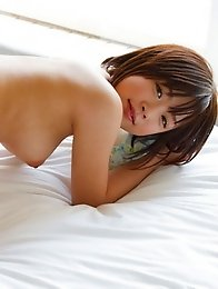 Beautiful and cute Japanese av idol Mana Sakura lies naked on her bed